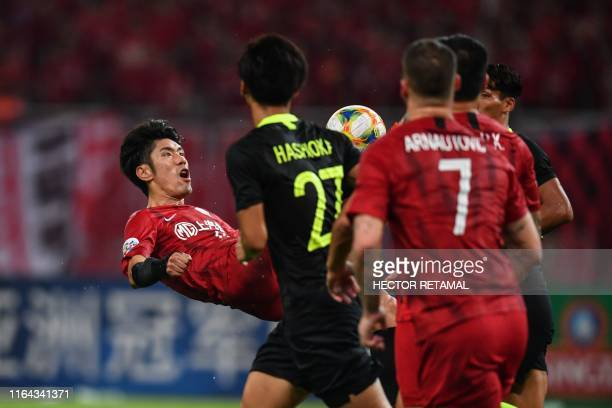 Shanghai SIPG's Lu Wenjun jumps to kick the ball in the match against Urawa Red Diamonds during their AFC Champions League quarterfinal football...