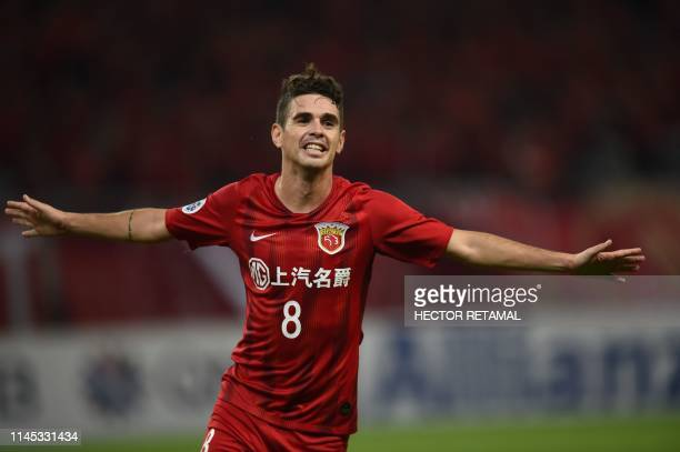 Shanghai SIPG's Oscar celebrates after scoring a goal during the AFC Champions League football match between Shanghai SIPG and Ulsan Hyundai in...