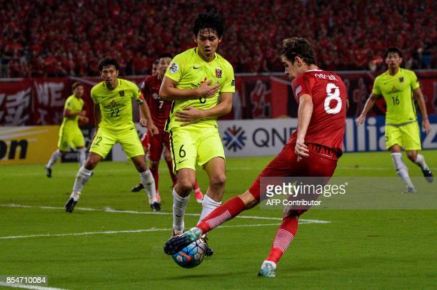 Shanghai SIPG's Oscar shoots the ball as Urawa's Endo tries to block during AFC Champions League semifinal football match between Shanghai SIPG FC...