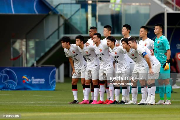 Shanghai SIPG's players pose for a group picture during the AFC Champions League Round of 16 match between Vissel Kobe and Shanghai SIPG at the...