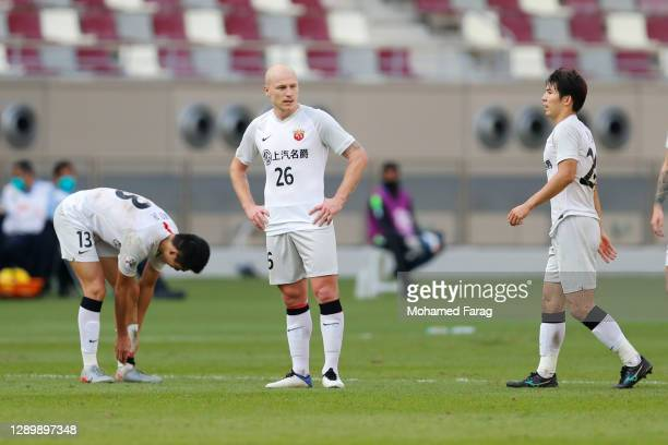 Shanghai SIPG's players react to their teams loss during the AFC Champions League Round of 16 match between Vissel Kobe and Shanghai SIPG at the...
