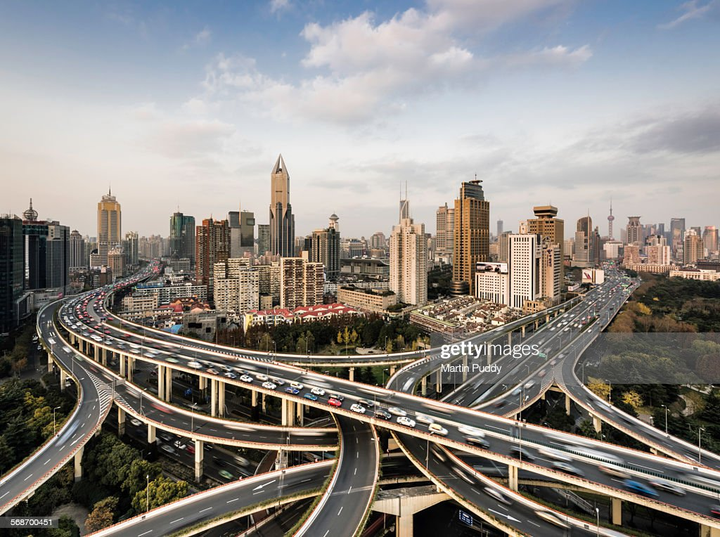 Shanghai skyline and busy road intersection : Stock Photo