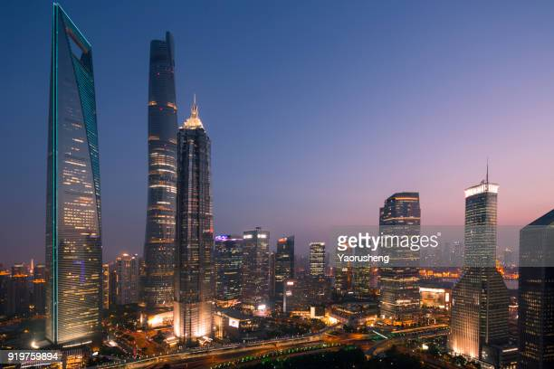 shanghai skyline and cityscape at sunset - business finance and industry stock pictures, royalty-free photos & images
