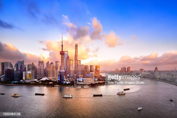 shanghai skyline at dusk - shanghai stock pictures, royalty-free photos & images