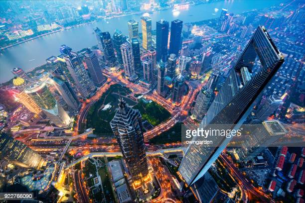 shanghai skyline at night - china stock pictures, royalty-free photos & images