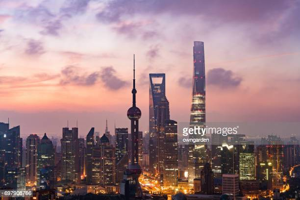 shanghai skyline at sunrise - oriental pearl tower shanghai stock pictures, royalty-free photos & images