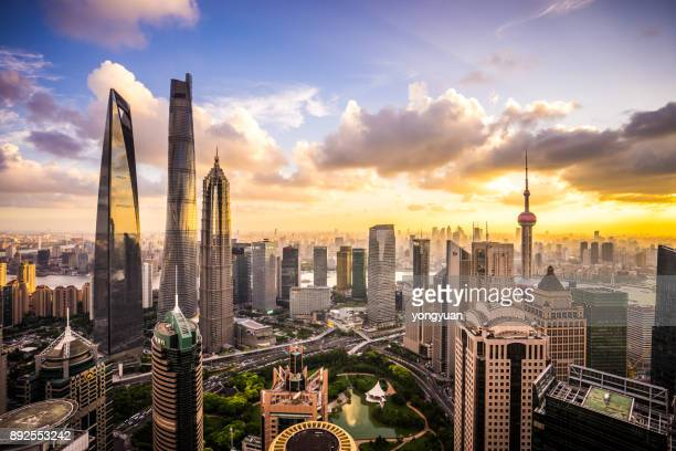 shanghai skyline at sunset - urban sprawl stock pictures, royalty-free photos & images