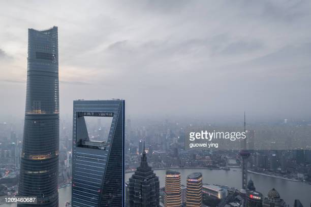 shanghai skyline in heavy fog - central bank stock pictures, royalty-free photos & images
