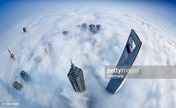 shanghai skyline in sea of clouds - majestic stock photos and pictures