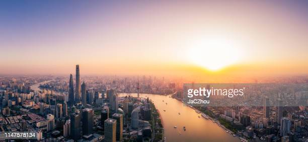 shanghai skyline sunset - prosperity stock photos and pictures