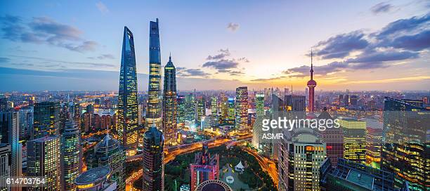 shanghai skyline sunset - tall high stock photos and pictures