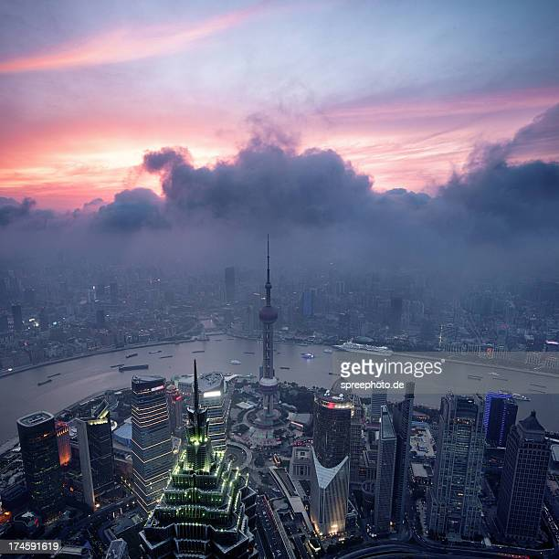 Shanghai Skyline with clouds and smog at sunset