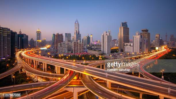 shanghai skylines and busy expressway at dusk, china. - shanghai stock pictures, royalty-free photos & images