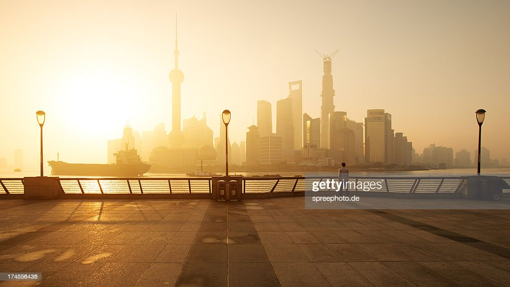 Shanghai sunrise at bund with skyline from Pudong : Stock Photo