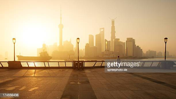 shanghai sunrise at bund with skyline from pudong - look back at early colour photography stock photos and pictures