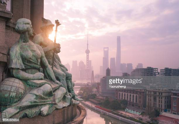 Shanghai sunrise morning.Ancient European sculpture culture and modern Chinese building at Lujiazui