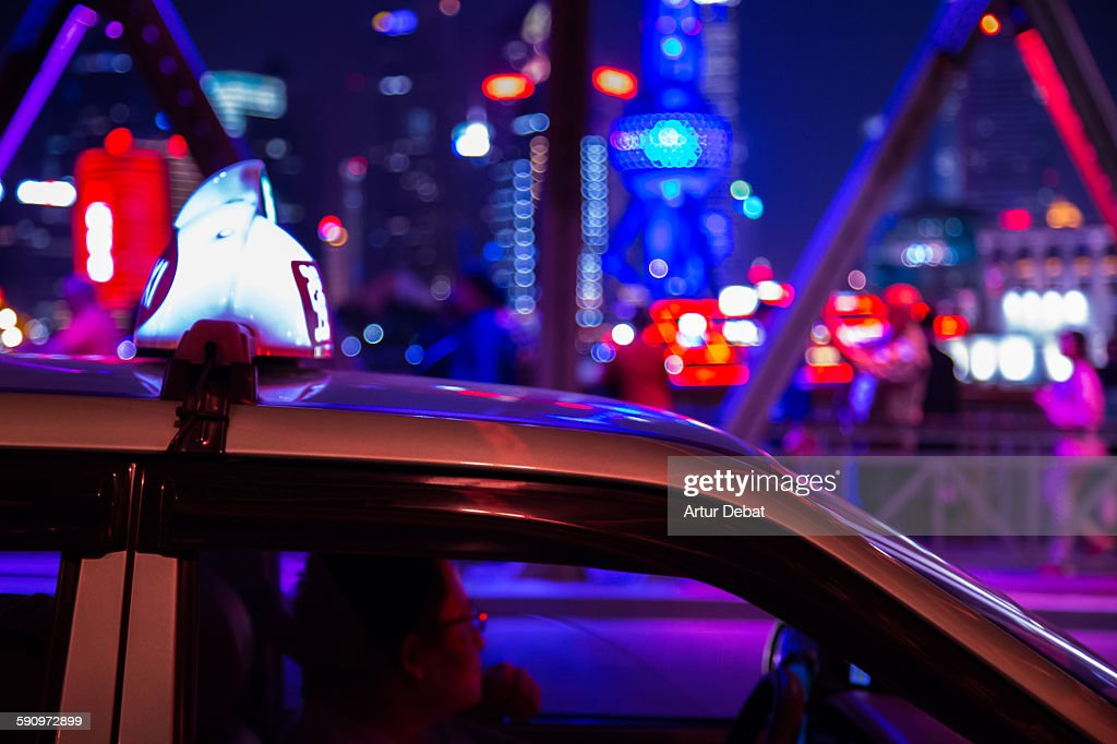 Shanghai taxi at night in the streets of the city. : Stock Photo
