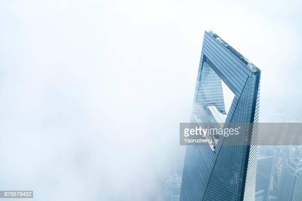 Shanghai World Finance center building in the fog