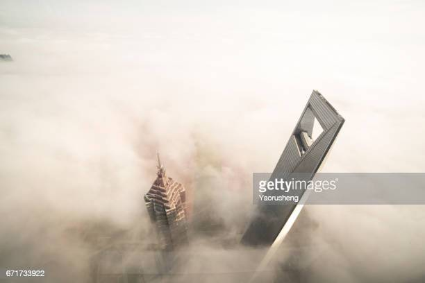 Shanghai World Finance center building in the fog,this building ,along with Jinmal building and Oriental Pear Tower are landmark of Shanghai city,located at Pudong area