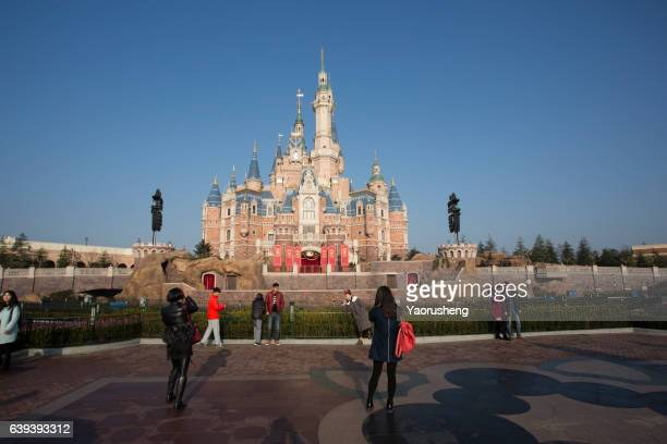 Shanghai,China-December 31,2016: Happy people visiting famous castle in Shanghai Disneyland Park,which is officially confirmed to open on June 16th, 2016.