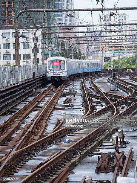 shanghai,china-september 16,2016:shanghai subway train line 3 approaching the station slowly - fast shutter speed stock photos and pictures