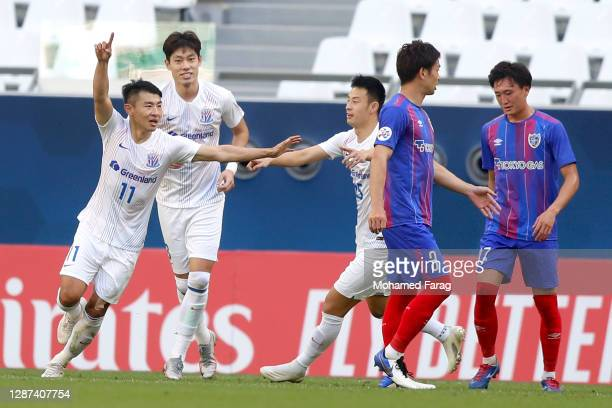 Shanghai's midfielder Yu Hanchao celebrates his goal during the AFC Champions League Group F match between FC Tokyo and Shanghai Shenhua at the...