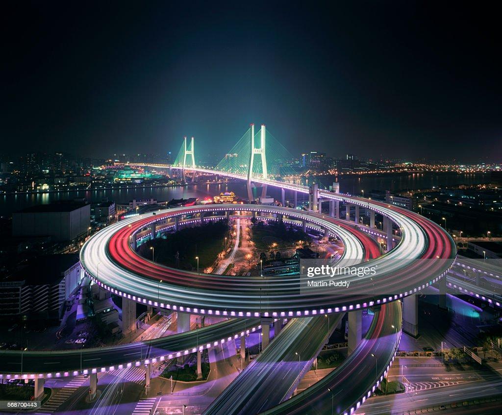 Shanghai's Nanpu bridge illuminated at night : Stock Photo