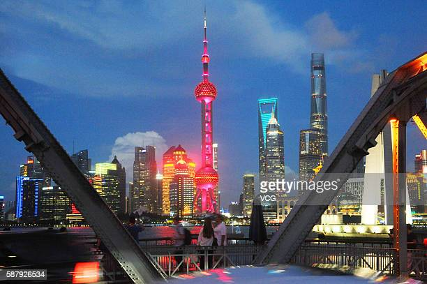 Shanghai's symbolic Oriental Pearl TV Tower lights up in colors of Chinese national flag to cheer for Chinese athletes and congratulate them on their...