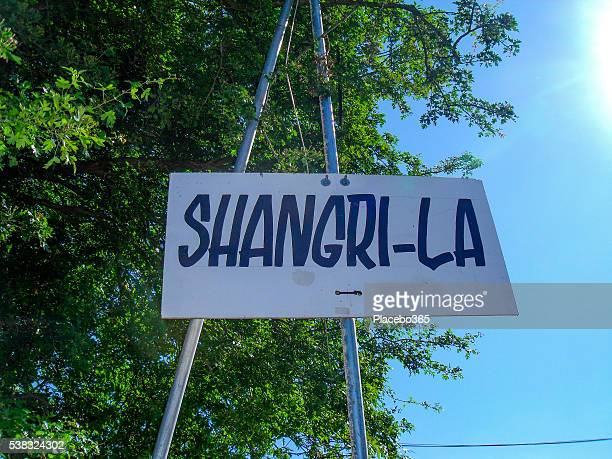 shangri-la sign glastonbury festival - garden of eden old testament stock photos and pictures
