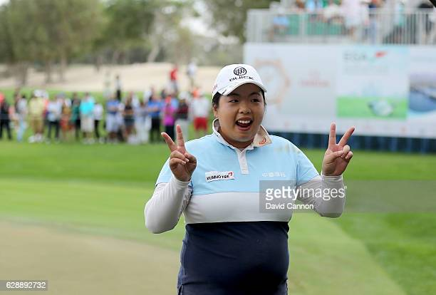 Shangshan Feng of China leaves the 18th green smiling after her round of 64 during the final round of the 2016 Omega Dubai Ladies Masters on the...