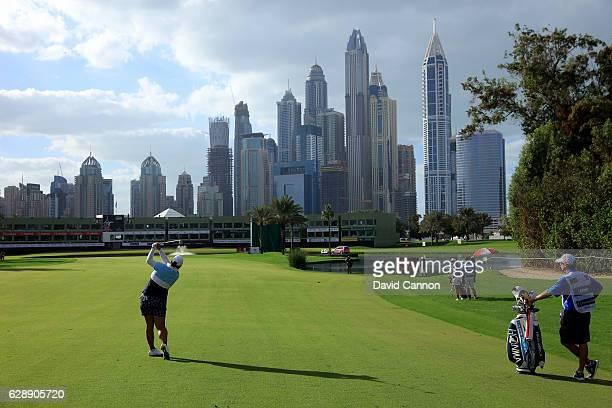 Shangshan Feng of China plays her second shot on the 18th hole during the final round of the 2016 Omega Dubai Ladies Masters on the Majlis Course at...