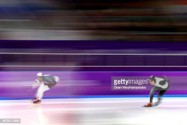 Shani Davis of the United States and Takuro Oda of Japan compete during the Men's 1000m on day 14 of the PyeongChang 2018 Winter Olympic Games at...