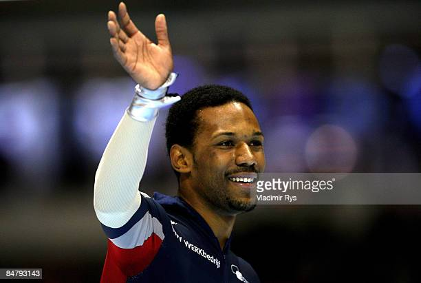 Shani Davis of the USA celebrates after winning over 1500m during the Essent ISU speed skating World Cup at the Thialf Stadium on February 14 2009 in...