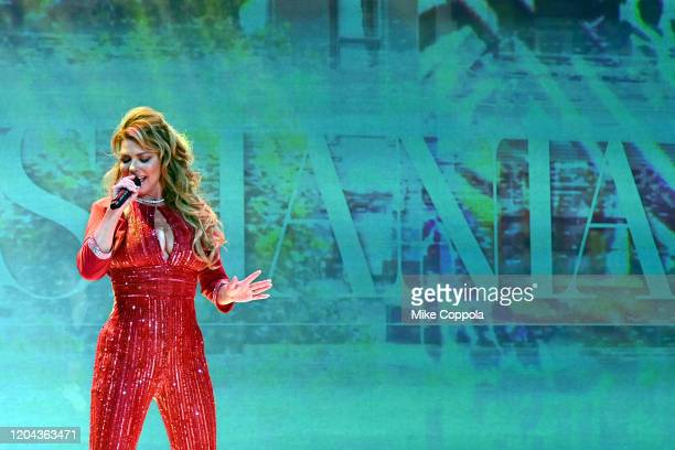 Shania Twain performs on the runway at the American Heart Association's Go Red for Women Red Dress Collection 2020 at Hammerstein Ballroom on...