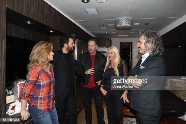 Shania Twain producer and founder of AMBI Media Group Andrea Iervolino John Travolta producer and founder of AMBI Media Group Monika Bacardi and...