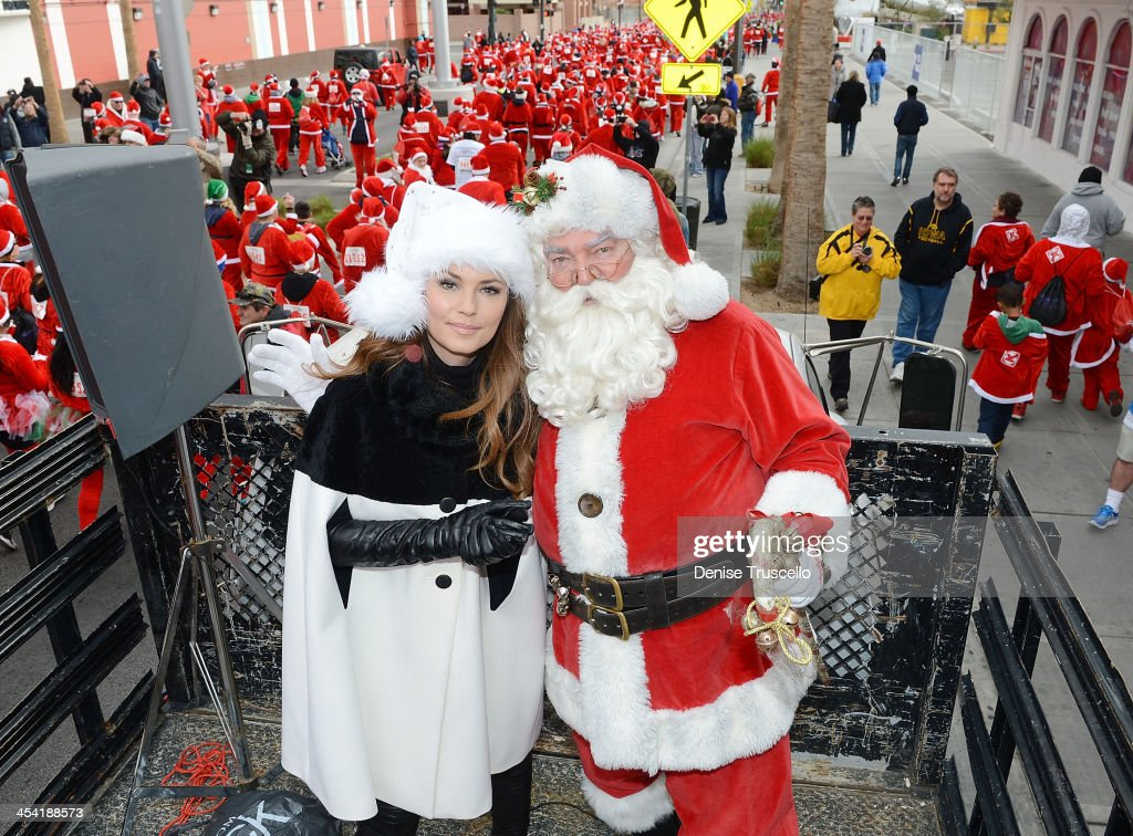 Shania Twain (L) serves as Grand Marshalfor the the 9th annual Opportunity Village Great Santa Run in Downtown Las Vegas on December 7, 2013 in Las Vegas, Nevada.