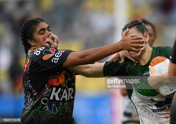 Shanice Parker of the Maori All Stars is tackled by Akira Kelly of the Indigenous All Stars during the NRL All Stars game between Indigenous and...