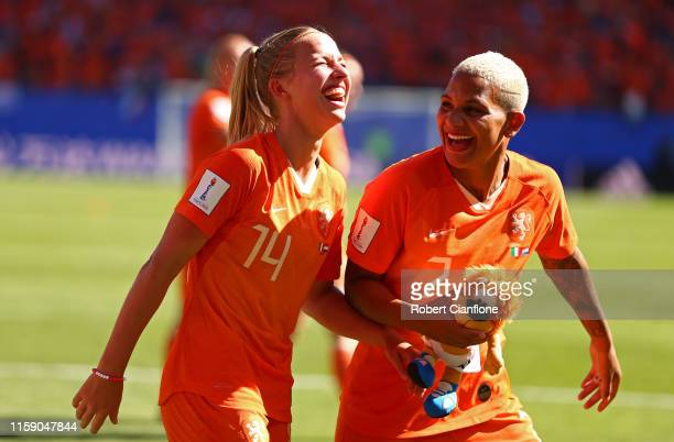 Shanice Van De Sanden and Jackie Groenen of the Netherlands celebrate following the 2019 FIFA Women's World Cup France Quarter Final match between...