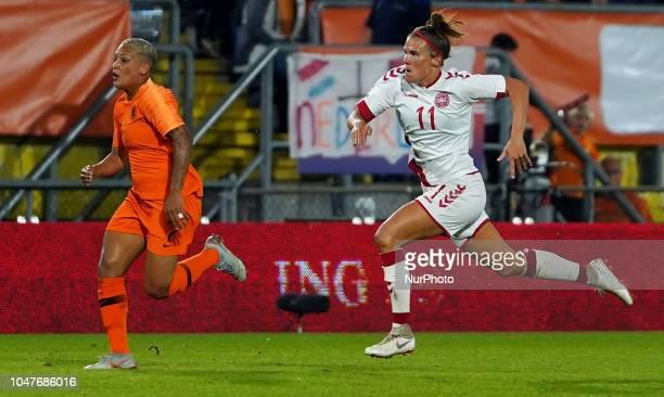 Shanice van de Sanden of Nederland beats of Katrine Veje of Denmark during UEFA European Qualifying Play Off Women's World Cup between Nederland and...