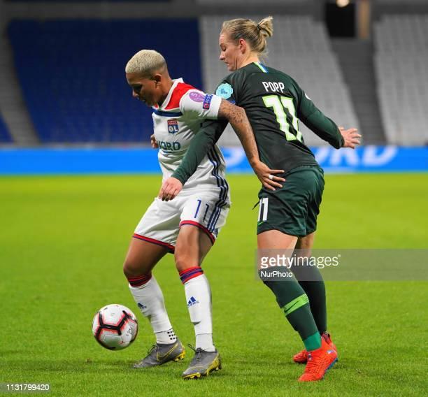 Shanice Van De Sanden of Olympique Lyonnais gets defended from Alexandra Popp of Vfl Wolfsburg during the UEFA Women's Champions League Quarter final...