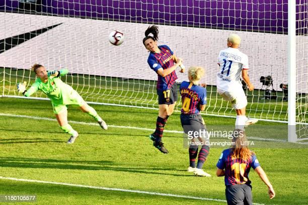 Shanice van de Sanden of Olympique Lyonnais Women and Andrea Pereira of FC Barcelona Women jump for a header during the UEFA Women's Champions League...