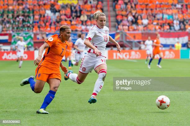 Shanice van de Sanden of the Netherlands and Cecilie Sandvej of Denmark battle for the ball during the UEFA Women's Euro 2017 final match between...
