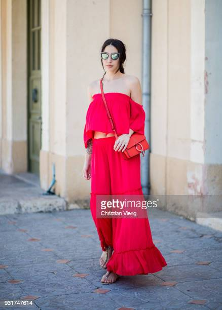 Shanie Goldstein wearing red off shoulder dress is seen during Tel Aviv Fashion Week on March 13 2018 in Tel Aviv Israel