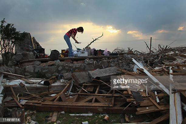Shanie Spencer salvages what she can from what remains of her house on May 28 2011 in Joplin Missouri After the town was hit by a massive tornado...