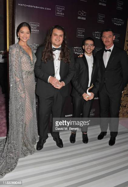 Shanina Shaik and Luke Evans pose with jointwinners of the ReadyToWear award Roni Helou and Salim Azzam at the Fashion Trust Arabia Prize awards...