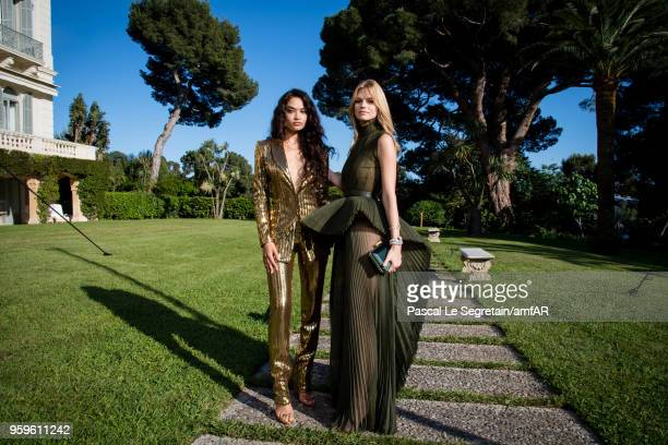 Shanina Shaik and Nadine Leopold pose for portraits at the amfAR Gala Cannes 2018 cocktail at Hotel du CapEdenRoc on May 17 2018 in Cap d'Antibes...