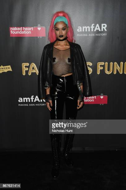Shanina Shaik attends the 2017 amfAR The Naked Heart Foundation Fabulous Fund Fair at Skylight Clarkson Sq on October 28 2017 in New York City