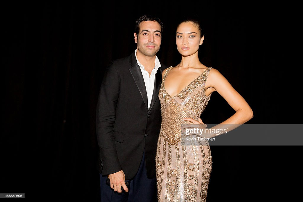 Shanina Shaik (R) attends the amfAR Milano 2014 - Gala Dinner and Auction as part of Milan Fashion Week Womenswear Spring/Summer 2015 on September 20, 2014 in Milan, Italy.