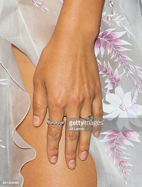 Shanina Shaik engagement ring detail attends The Weinstein Company and Netflix Golden Globe Party presented with FIJI Water Grey Goose Vodka Lindt...