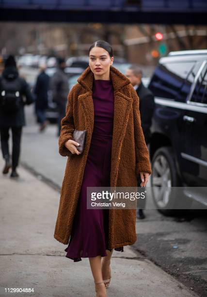 Shanina Shaik is seen wearing dress teddy coat outside Boss during New York Fashion Week Autumn Winter 2019 on February 13 2019 in New York City